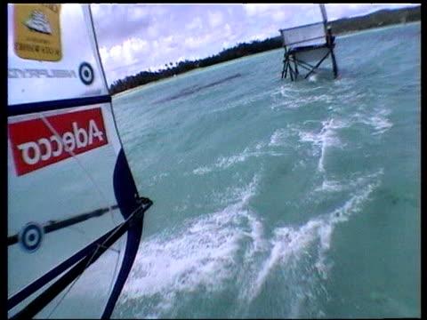 Helmet camera on windsurfer speeding across shallow blue waters Boracay