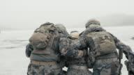 Helping Injured Soldier