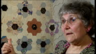 Henderson interview SOT Close shots of quilt with children's names embroidered in centre of patterns