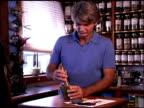 Herbalist preparing organic herbs