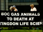 Hertfordshire Tape recorder lying on grass in front of building playing sound of screaming terrified animal with Animal Rights protest banner in b/g...