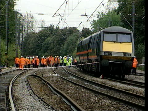 TRANSPORT LIB Hertfordshire Hatfield Seq showing derailed train at Hatfield and rail and rescue workers about on track buckled track