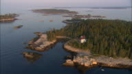 LOW AERIAL, Hewet Island at sunrise, Maine, USA