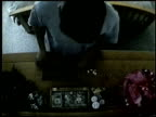 / hidden camera captures maid stealing items from bureau in employer's bedroom Home burglary in progress on October 10 2005 in Tampa Florida