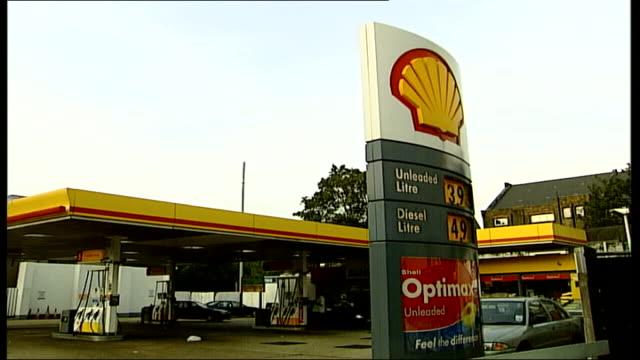 Hidden mobile phone mast concerns ENGLAND London EXT i/c GV Shell petrol station forecourt MS Petrol station sign with concealed mobile phone...