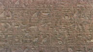 CU TD Hieroglyphics engraved on stone tablet in front of Great Sphinx / Giza, Egypt