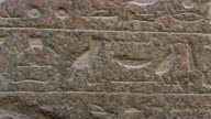 CU PAN Hieroglyphics engraved on stone tablet in front of Great Sphinx / Giza, Egypt