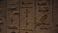 Hieroglyphics inside an Ancient Egyptian tomb Pan to young woman Located in the 'Valley of the Kings'