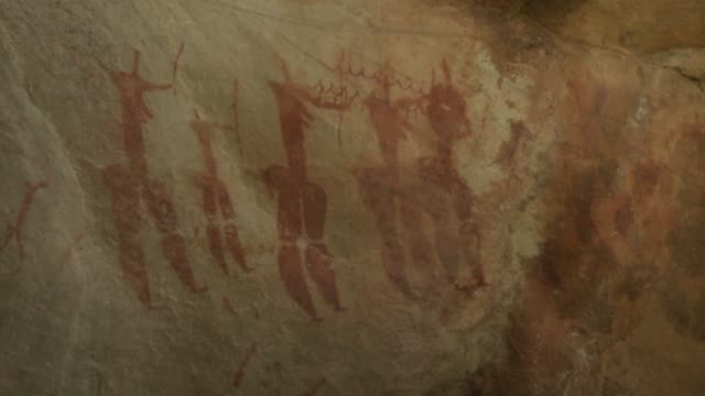 Hieroglyphs decorate rock walls. Available in HD.
