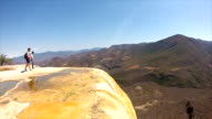 Hierve el Agua, petrified waterfalls with natural infinity pools looking over forest valley