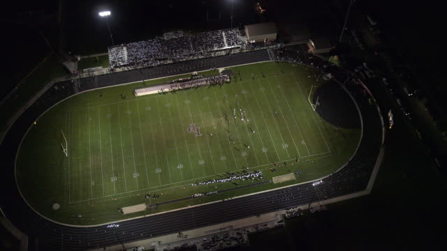 High aerial view of high school football game