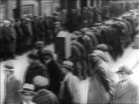 B/W 1929 high angle 2 long lines of men waiting for handout / Great Depression / newsreel
