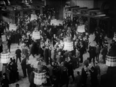 B/W 1929 high angle action on floor of NY Stock Exchange / newsreel