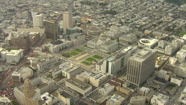 High Angle aerial push,in , Office buildings and other high rises crowd San Francisco. / San Francisco, California, USA