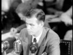 B/W 1949 high angle Alger Hiss testifying to HUAC denying that he is a Communist / newsreel
