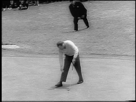 B/W 1966 high angle Billy Casper making hole at US Open / shakes hands with Arnold Palmer / newsreel