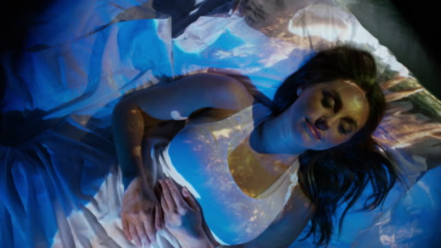 High angle close up of projections on sleeping woman / Cedar Hills, Utah, United States