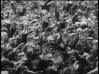 B/W 1929 high angle crowd giving fascist salute at rally at Nuremberg / newsreel