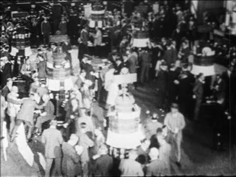 B/W 1929 high angle PAN crowded floor of New York Stock Exchange / Wall Street NYC / newsreel