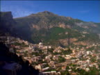 high angle PAN from city to ocean in Positano on Amalfi coast / Italy