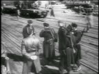 B/W 1950 high angle group of soldiers standing on wooden platform outdoors / Berlin / newsreel