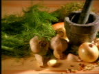 high angle PAN healthy foods laying out on table / garlic, onions, cinnamon, ginger, sprouts, celery