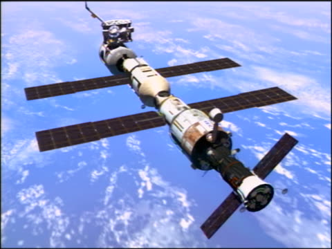 COMPUTER ANIMATED high angle International Space Station components breaking away in outer space