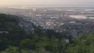 High angle long shot across the city of Rio de Janeiro.