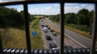 High Angle Long Shot Holiday traffic on the A303 near Stonehenge in Wiltshire crawls along the road heading west towards the holiday destinations in...