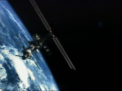 High angle long shot view of the International Space Station orbiting the Earth