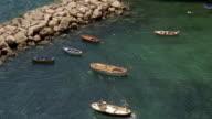 High angle medium shot boats moored off the coast of Conca dei Marini / Salerno, Amalfi Coast, Italy