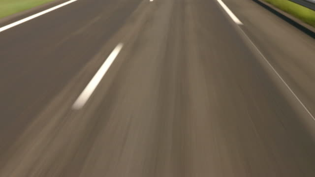 High angle medium shot car point of view dashed white line on motorway / France