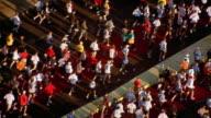 High angle medium shot crowds of marathon runners on bridge / Chicago