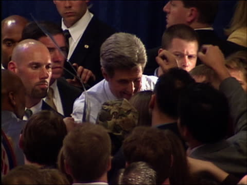 2004 high angle medium shot John Kerry talking to and shaking hands with DNC delegates / Washington DC