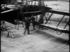 B/W 1918 high angle men assembling DH4 airplane in factory / World War I