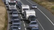 High Angle Mid Shot Holiday traffic on the A303 near Stonehenge in Wiltshire crawls along the road heading west towards the holiday destinations in...