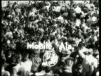 B/W high angle of cheering crowd / Mobile AL / Title in shot / NO