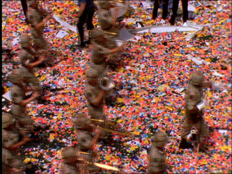 high angle of military marching band in ticker tape parade / Operation Welcome Home / NYC