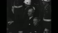 MS high angle of Nazi Youth Leader Baldur von Schirach and Nazi forced labor director Fritz Sauckel listening thru headphone translators at Nuremberg...