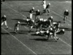 B/W high angle of quarterback making touchdown in football game / Mobile AL / NO