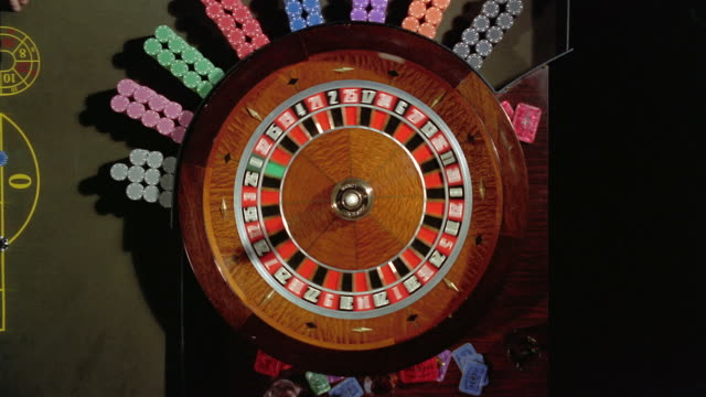 High angle overhead view of roulette wheel spinning