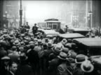 B/W 1931 high angle people crowding around car on city street to see Al Capone