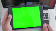 High angle shot of man using digital tablet,Green screen