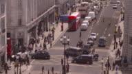 High angle shot of traffic and pedestrians travelling along Upper Regent Street, London.