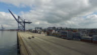 High angle shot of transporter lorries travelling along the waterfront of the port of Felixstowe