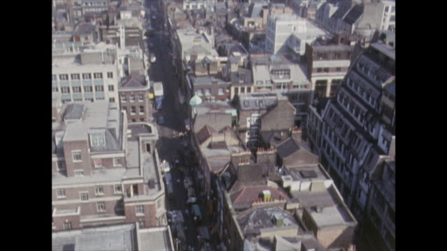High angle shot over the streets of Soho zooming into market stalls