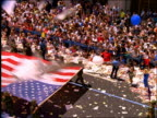 high angle soldiers carrying American flag in ticker tape parade / Operation Welcome Home / NYC