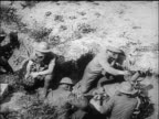 B/W 1917/18 high angle soldiers in trenches wearing gas masks helmets / World War I / newsreel