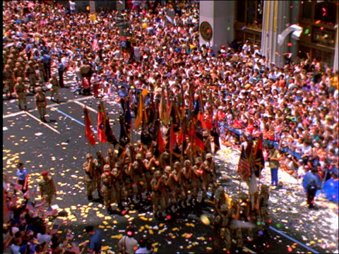 high angle PAN of soldiers marching in ticker tape parade / Operation Welcome Home / NYC