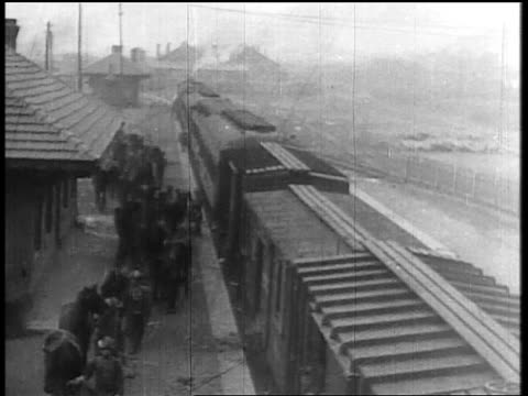 B/W 1931 high angle soldiers standing near train on train platform / Japan invading Manchuria
